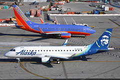 Two Ships Pass in the Day (Rich Snyder--Jetarazzi Photography) Tags: horizonair horizon qxe qx alaskaairlines alaska asa as embraer emb170200lr erj175lr e175 e75l n626qx southwestairlines southwest swa wn boeing 737 737700 7377h4 b737 b73g n256wn taxi taxiing arriving arrival departure departing pass sanfranciscointernationalairport sfo ksfo millbrae california ca airplane airliner aircraft jet plane jetliner ramptowera rcta atower regionaljet rj