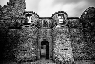 approaching the front gate of Tolquhon Castle, fine art black & white view of this modest baronial chateau, Aberdeenshire, Scotland