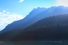 The blue canoe (fred.colbourne) Tags: twojack banffnationalpark alberta canoe lake landscape flare mountains