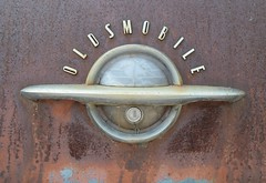 unlock the world (David Sebben) Tags: oldsmobile rocket 88 trunk badge world globe rust patina iowa