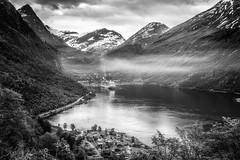 Geiranger in BW (wandering indian) Tags: kedardatta landscape geiranger fjord norway europe lake boattrip waterfall explore nature travel reflection pano boat ship nikon longexposure