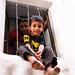 boy staring out of the window, Sanaa, Yemen