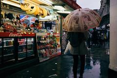 Open All Hours (lsullivanart) Tags: thecity thecityoflondon londontown capital london england britain unitedkingdom uk europe urbanstreet urbanpeople urbanview urbanscene urbancandid candid humanity human people rawstreets streetlife life view streetview streetscene streetphoto streetshoooter streetshot streetart streets street streetshooter streetphotographer streetphotographycolour streetphotography outdoor atmospheric dramatic clouds sky autumn x70 fujix70 fujinon fujix fujifilm fuji snapshot snap shoot shooter shot photography piccadillycircus piccadilly leicestersquare rain raining reflections wet