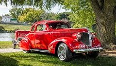 It's The Real Thing (Wes Iversen) Tags: autofest cassriver frankenmuth michigan nikkor18300mm pontiac automobiles carshows cars chrome classiccars red rivers transportation trees vintage water