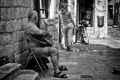 I'll Sing The Sound Until You Turn Around (Alfred Grupstra) Tags: people street urbanscene blackandwhite men sitting outdoors poverty old citylife bicycle cultures women city oldfashioned editorial males travel mentenegro kotor