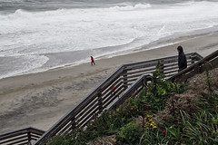Storm Watchers (brucetopher) Tags: storm hurricane surf dangerous windy wind gale tropicalstorm blow gusts winddriven beach waves power force forceful wash breakers loud steps stairs landing walkway path boardwalk ocean sea rough hazardous cloudy woman man girl boy coat