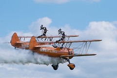 Wing Walkers (Lauren Taliana) Tags: elements flickr wingwalkers aeroplane airplane wings sky clouds fly flying transport aircraft flyingmachines vintage aviation shuttleworth
