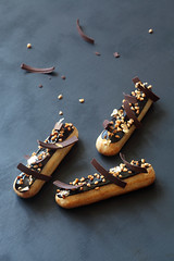 Chocolate Hazelnut Eclairs (Мiuda) Tags: eclairs éclairs vanilla sweet sweets choux pastry rose pink baking bake baked bakery confectioner confectionery patisserie patissier food dessert delicious sugar cream creamy café white chocolate hearts decoration icing tasty yummy french paris homemade professional pastel pretty dreamy clean foodphotographer photography foodphoto blogger blog foodblog hazelnut caramel glaze mirrorglaze chocolateglaze praline nutella