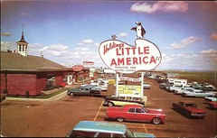 """""""Holding's Little America."""" Wyoming Roadside Travel Center & Gas Station. Photo by Mike Roberts. Postcard SC9977, (ca. 1960s) (lhboudreau) Tags: postcard postcards colorphoto outdoor outdoors vintagepostcard road sc9977 nosc9977 postcardsc9977 postcardnosc9977 roadsideamerica littleamerica gasstation gas gasoline sinclair sinclairgasoline vintage car cars auto autos automobile automobiles retro holdingslittleamerica travelcenter wyoming roadside 1960 1960s fillup gasup ontheroad roadtrip travel roadtrips servicestation gaspumps gaspump penguin sign signs intermountaintouristsupply mikeroberts vintagecars vintageautos vintageautomobiles advertising advertisingpostcard"""