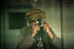 reflected self-portrait with Balda Baldessa-F camera and plush yellow hat (pho-Tony) Tags: cameraselfportraits baldessaf balda baldabaldessaf prontor 125 prontor125 isconar 128 f28 45mm 35mm film isco colorisconar baldessa german germany 1960s agfa vista poundland rollei digibase c41 exhaused failure underdeveloped exhausedchemicals