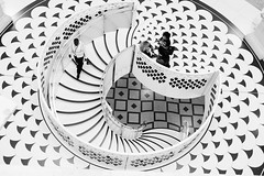 Holed Out (Douguerreotype) Tags: monochrome spiral buildings city bw uk geometry gb england british blackandwhite mono stairs architecture britain geometric london urban helix people steps