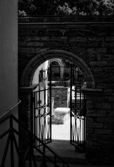 Going down to the light (Мaistora) Tags: gate gateway entrance door arch stairs stairway down downward descending court courtyard garden light sunlight silhouette backlight backlit contrejour frame framed framing wall castle masonry stone historic history ancient antique oldcity oldtown citadel iron wrought mood atmosphere feeling shine glow baku baki azerbaijan bw blackandwhite mono monochrome analog film silver paper print grain contrast graphic sony alpha ilce a6000 sel1650pz dxo optics luminar stairwaytoheaven takethestairsdowntoheaven