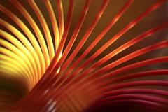 Inside my Slinky (Elisafox22 A bit ON/OFF at the moment!) Tags: elisafox22 sony nex6 e30mm f35 macro macrolens abstract hmm macromondays slinky plastic rainbowslinky shadows light dof lines curves colours elisaliddell©2017 macrodreams memberschoiceabstractmacro