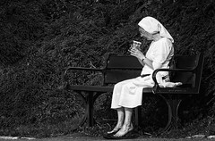 A Peaceful Break ... (Go placidly amidst the noise and haste...) Tags: nun plymouthhoe plymouth hoe coffee morning blackandwhite blackwhite habit bench mono