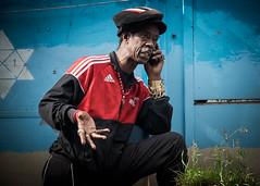You Get Me Brother? (XBeauPhoto) Tags: london tam adidas blaxploitation bling candid comic conversation gold jewelry man phone portabelloroad streetphoto streetphotography tracksuit urban westindian