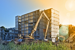 Demolished building (hobbes_s2001) Tags: demolition demolished development construction mover excavator site sun flare