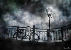 Dutch Bicycle (YvonneRaulston) Tags: amsterdam the netherlands europe shower wet rain raindrops bicycle bike lamp light bridge texture sony atmospheric moody