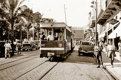 Early October 1941 - Tram No. 151 passes Martyr's Square in El Shouhada, downtown Beirut, Syria (now Lebanon) (aussiejeff) Tags: beyrouth beirut syria lebanon sepia boxbrownie ww2 australianarmy wwii war australia vintage historic tram no151 shops signs advertising مارنقولا jeffc aussiejeff street track