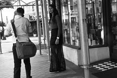 Bohemian Woman (Michael Goldrei (microsketch)) Tags: december skirt messsucher street shop m flagler florida lady photos dress girl leica monochrome st system photography 15 black bag america series shops downtown photo mseries bohemian man boho monochrom cameras woman mspf miamistreetphotographyfestival historymiami 2015 seethru rangefinder rangefinders seethrough us satchel akademia white camera attention historymiamiphoto mspf2015 history blackandwhite dec usa msystem photographer