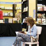 Child enjoying a read in the Baillie Gifford Children's Bookshop
