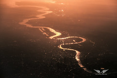 Sunrise over London - Aerial view (gc232) Tags: sunrise london sun light livefromtheflightdeck live from flight deck thames river aerial pilots view altitude drone plane airplane fly flying travel uk united kingdom england europe city above sunset dawn dusk morning haze