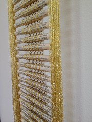"A Prayer for Owen Meaney ""detail"" (Peggy Dembicer) Tags: peggycorallo dembicer connecticutartist bookart recycled reclaimed upcycled recycledart unique original coiledpaper art design gold lurex fiberart surfacedesign bookpages diy doityourself"