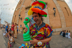 The balloon man of Altea (Dafydd Penguin) Tags: globos baloon man balloon altea colour street raw candid photo spain valencia spannish square nikon df nikkor 16mm af f28d fisheye