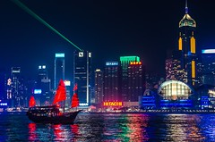 A Hong Kong Junk in front of the cities skyline. (Sander Pot) Tags: 50mm d7000 nikon darksky sky dark composition architecture reflection water sea neon neonsign hitachi colors nightshot night red buildings skyscrapers skyscraper china asia capital city cityscape skyline lasers laser lasershow sailing sailingboat junk hongkong hongkong2016