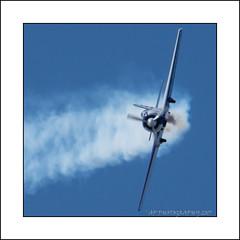 Banking hard right (prendergasttony) Tags: plane aeroplane prop propellor smoke wings flight sky blue aerobatic nikon d7200 lancashire airshow yakovlev yak50 monoplane ƒ140 3000 mm 1800 iso400 england яковлев як50