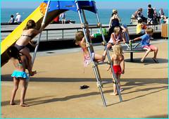 Spielplatz am Meer (sinepo) Tags: spielen kinder meer geräte rutschbahn badeanzug bikini sonne karussel leiter klettern