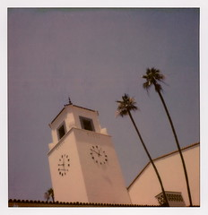 Clock Tower Trees 2 (tobysx70) Tags: the impossible project tip polaroid sx70sonar sonar instant color film for sx70 type cameras impossaroid clock tower trees union station alameda street dtla downtown los angeles la california ca palm leaves blue sky amtrak railway railroad terminus 1250 pm toby hancock photography