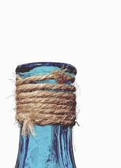 Display Bottle (jesse1dog) Tags: macromondays highkey bottle displaybottle string cord blue macro lf1 hairy tabletop