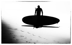 Bored with the Board (Andy J Newman) Tags: monochrome blackandwhite street candid convention elvis silverefex nikon silhouette surfer beach portcawl