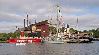 The lightship Finngrundet, a motorboat, the mine sweeper M20, the HMS Falken and the icebeaker Sankt Erik at Galaärvarvet in Stockholm. In the background the Vasa museum.