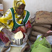 An internally displaced woman in Somalia receives food