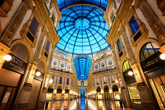 Early morning at the Galleria Vittorio Emanuele (Pat Charles) Tags: galleriavittorioemanuele gve milan milano lombardy lombardia italy italia italian shops shopping mall expensive highend symmetry architecture architectural dome duomo leadinglines reflection reflected reflections arches travel europe city urban exploration longexposure tripod nikon