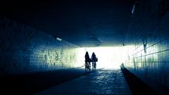 das Licht am Ende des Tunnels (Eric Spies) Tags: tunnel ende licht end light blau blue arnheim arnhem gelderland guelders bikes bicycles cyclists radfahrer fahrräder nederland holland niederlande netherlands fuji fujifilm fujinon xt10 xc1650 monochrom monochrome mono crossentwicklung elderveld schuytgraaf noord fietstunnel einde blauw intothelight backlight gegenlicht tegenlicht silhouette silhouetten silhouettes fietsen fietsers arnhemzuid elden street konturen