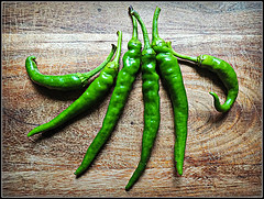 Eat your greens! (Jason 87030) Tags: peppers chili composition choppingblock board frame border hot green verde vert vegetables spice ingredients stilllife food