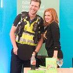 A delighted police officer meets Isla Fisher at her book signing