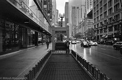 Soggy City In Monochrome -  (5 of 11).jpg (Milosh Kosanovich) Tags: cloudgate block37 statestreet chicago bean bw bwfilm minoltax700 kodaktmax400 film wet millenniumpark chicagophotographicart epsonv750pro night chicagoist chicagophotographicartscom miloshkosanovich mickchgo macys chicagophotoart minolta50mmf14 rain kodak400tmax