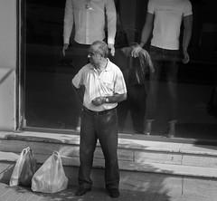 Guardian Angels (wjshawiii) Tags: albania streetscenes tirana alone bw blackandwhite standing waiting