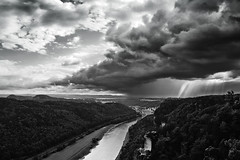 Showers Ahead [B&W Version] (parkerbernd) Tags: rain showers ahead hole dramatic clouds sky cloudburst river elbe valley sandstone mountains rock formations rocks bastei bastion bridge castle malerweg view outlook rathen saxon switzerland saxony sachsen panasonic lumix gx1 germany bw black whaite