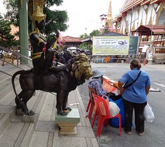 stop, don't buy that lottery ticket (the foreign photographer - ฝรั่งถ่) Tags: lottery ticket vendor lion stop fear laksi buddhist temple bangkok thailand sony