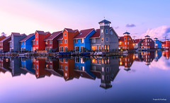 The colorful houses of Groningen (Prajeesh Prathap) Tags: sunset blue hour bluehour night colorful building canal netherlands holland dutch groningen reitdiephaven reflection water calmwater calm serene houses waterside nightscape longexposure