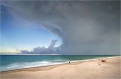Early evening thunderstorm. (Jill Bazeley) Tags: thunderstorm sky cloud cumulus towering atlantic ocean beach pelican satellite lifeguard stand tower fishing fisherman surf long exposure space coast brevard county florida sony a6300 1018mm smooth reflection app cumulonimbus