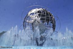 UNISPHERE. FLUSHING MEADOWS CORONA PARK. NEW YORK CITY. (ALBERTO CERVANTES PHOTOGRAPHY) Tags: unisphere newyork nyc usa flushing meadows corona park parque photography retrato portrait feriamundialde1964 1964worldsfair 1964 feria mundial fair world acero planetatierra planetearth planeta tierra planet earth steel iron elementocentral centerpiece elemento central estructura structure globo globe peace symbol simbolo paz agua water wheel rueda cielo sky azul blue queens city ciudad sol sun efecto effect silkwater sedaenelagua silkeffectinwater seda silk flushingmeadowscoronapark