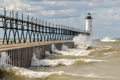 September Gale (Aaron Springer) Tags: michigan northernmichigan lakemichigan thegreatlakes manisteenorthpierheadlight breakingwaves lighthouse pier water sunlit outdoor nature seascape