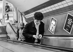 London Underground, August 2017 (S.R.Murphy) Tags: august2017 fujix100t london socialdocumentary streetphotography londonunderground taylorswift lookwhatyoumademedo bw bnw monochrome mono people songlyrics lyrics blackandwhite whiteandblack