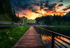 Walking to the Sunrise (Croosterpix) Tags: lake morning sunrise reflection clouds sky colors dolomiti dolomites misurina sony a7r nikkor1835