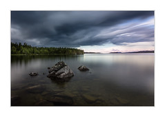 Calm before the storm (Explored august 8, 2017) (Andreas Larzon Photography) Tags: afternon andreaslarzon blackclouds blue cape cloudy forrestlandscape glasswater googlenikcollection heavycluds lake landscape longexposure lowclouds mirrorwater naturephotography nikond7200 rocks ruleofthirds sea seascape sidelight sigma1835mmf18dchsmart stormclouds storuman sweden västerbotten atmospheric gloom gloomy seaside